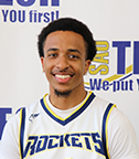 young man in basketball uniform