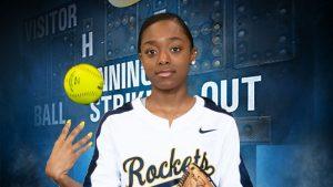 softball player with ball