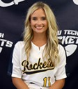 blonde girl in softball jersey