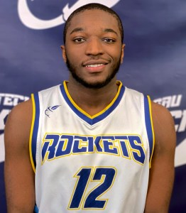 Young man smiling wearing a basketball jersey