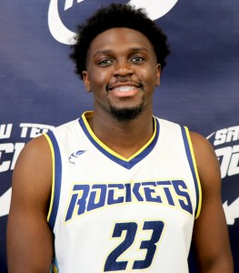 Young man smiling in basketball uniform