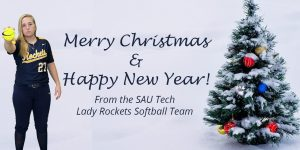 young woman in softball uniform with Christmas tree